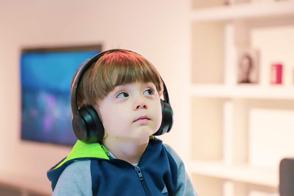 young vision impaired child receiving audio description